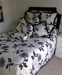 Floral Quilt In Contrasting Black Edging