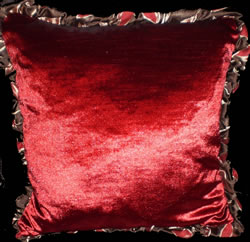 Faux Silk Edged Cushion In Striking Red Contrasts